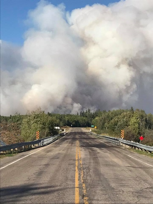 UPDATED – Wildfires in northeast Sask. force closure of highway
