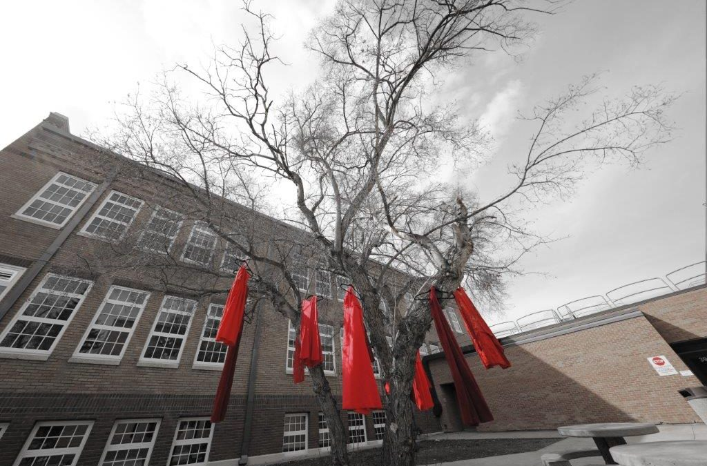 Sask. Polytechnic honours Missing and Murdered Indigenous Women and Girls with red dress displays