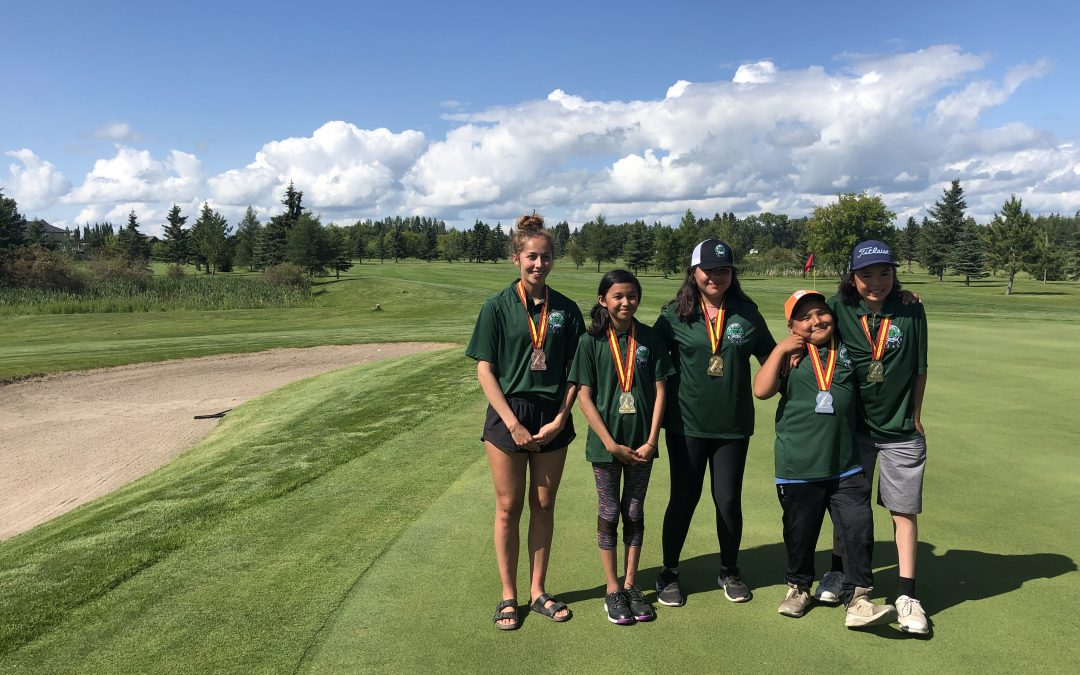 Team Woodland wins three golf medals