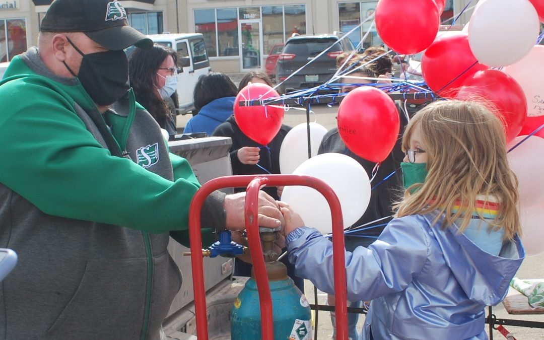 Prince Albert Co-op releases balloons in memory of family victimized by 2020 attack